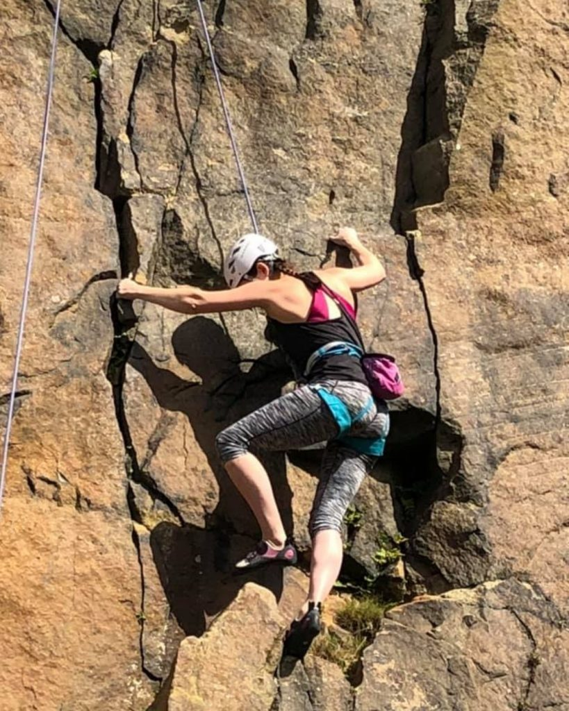 Attendee ascending the rockface